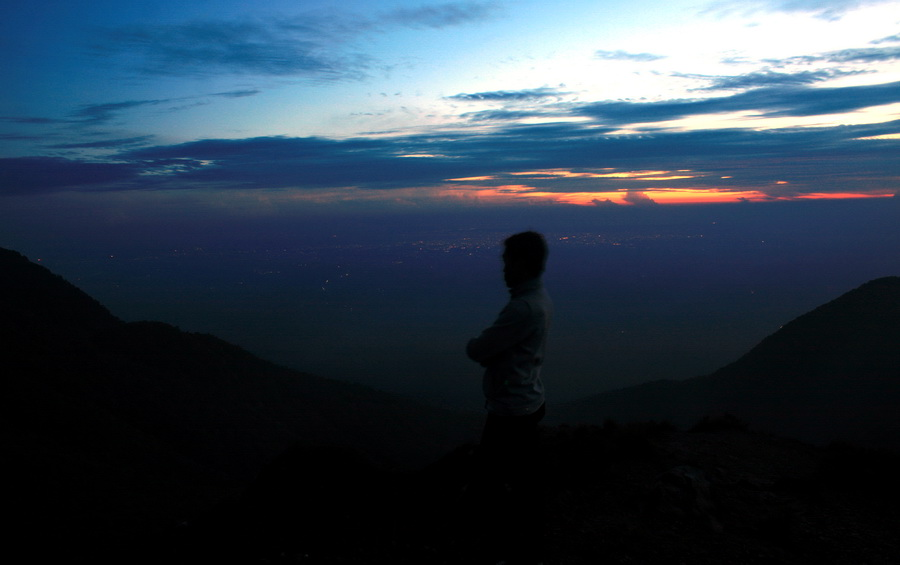 From the top you can see the light of the town. Beautiful moment. (photo credit: joko guntoro using automatic timer)